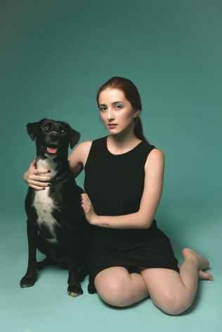 photo of woman beside dog